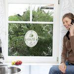 """Produktfoto-Fensterbild, Küchenfenster mit Aufkleber """"Cafe"""", rechts sitzt hübsche Frau und telefoniert"""